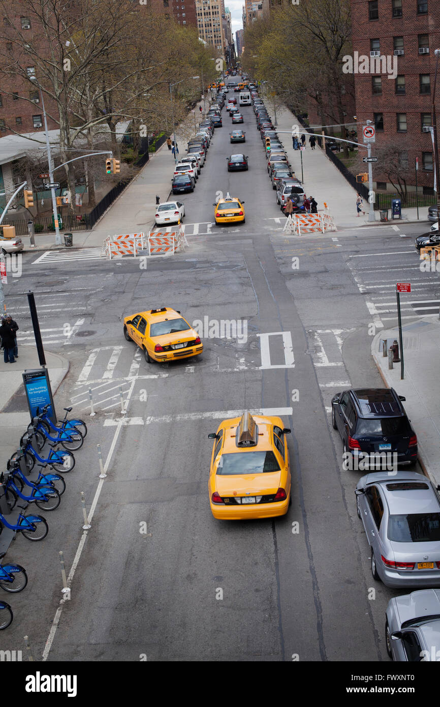USA, New York City, Street traffic with yellow cabs - Stock Image