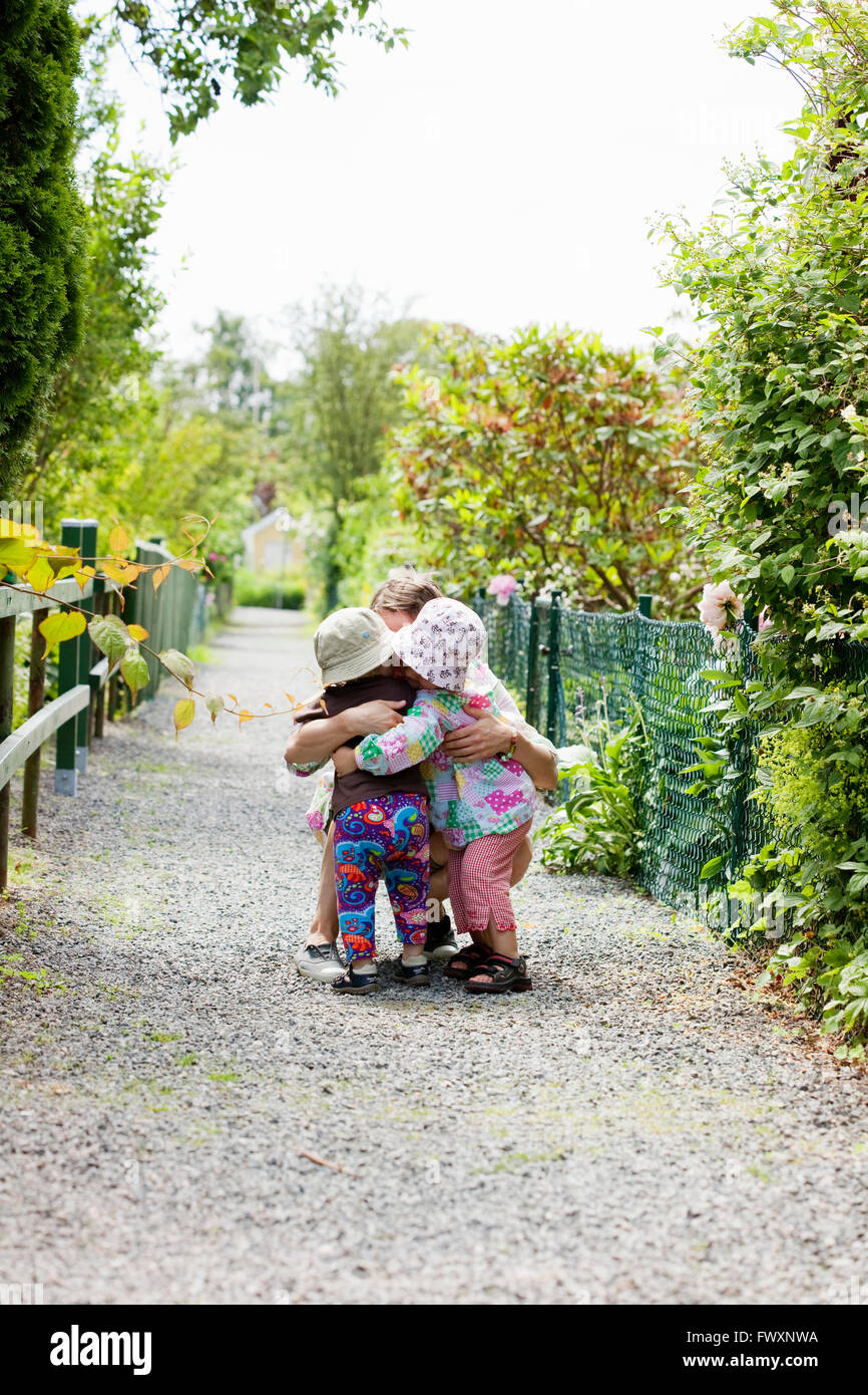 Sweden, Vastra Gotaland, Gothenburg, Mother hugging daughter (2-3) - Stock Image