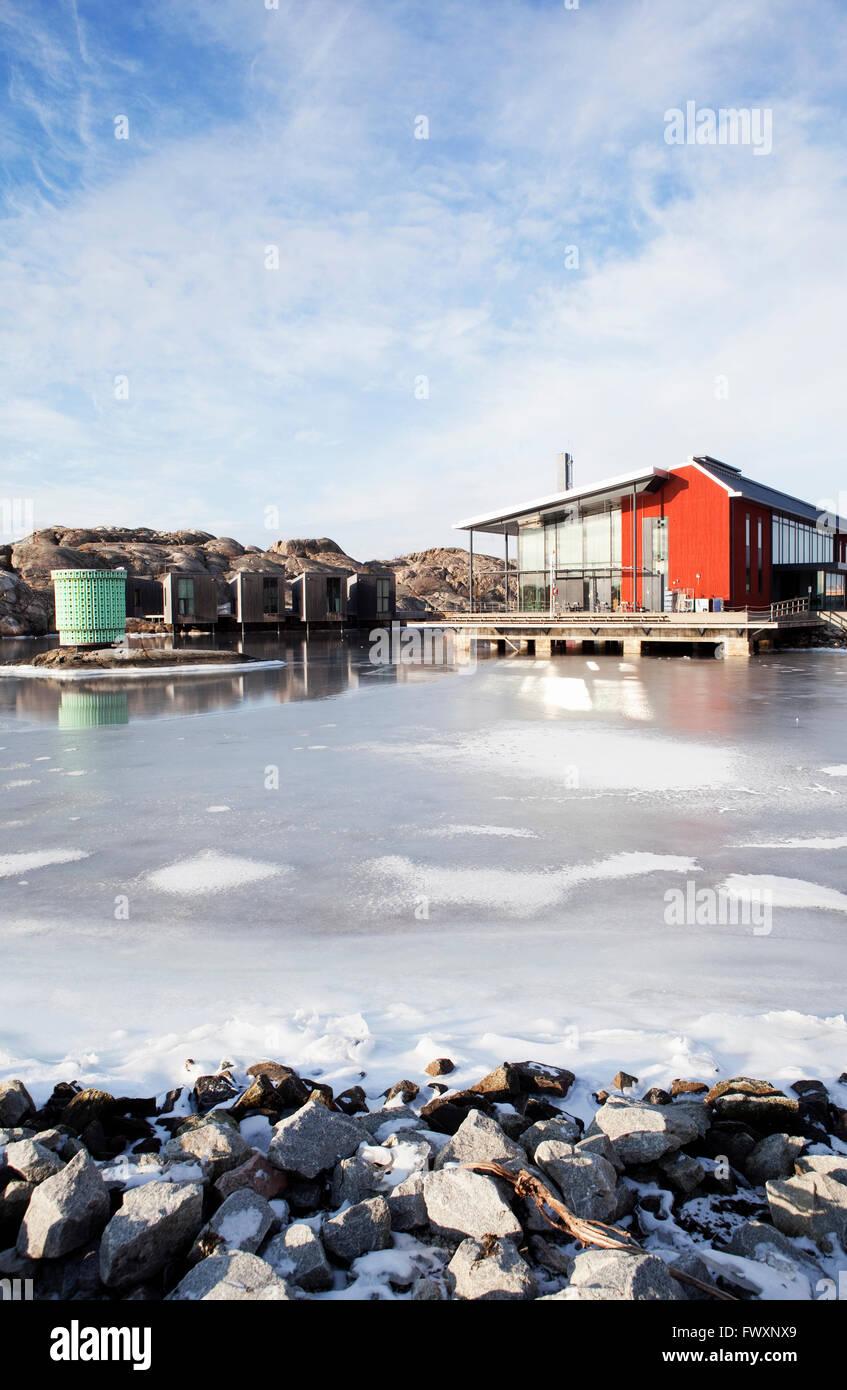 Sweden, Bohuslan, Orust, Skarhamn, Wooden house by frozen sea Stock Photo