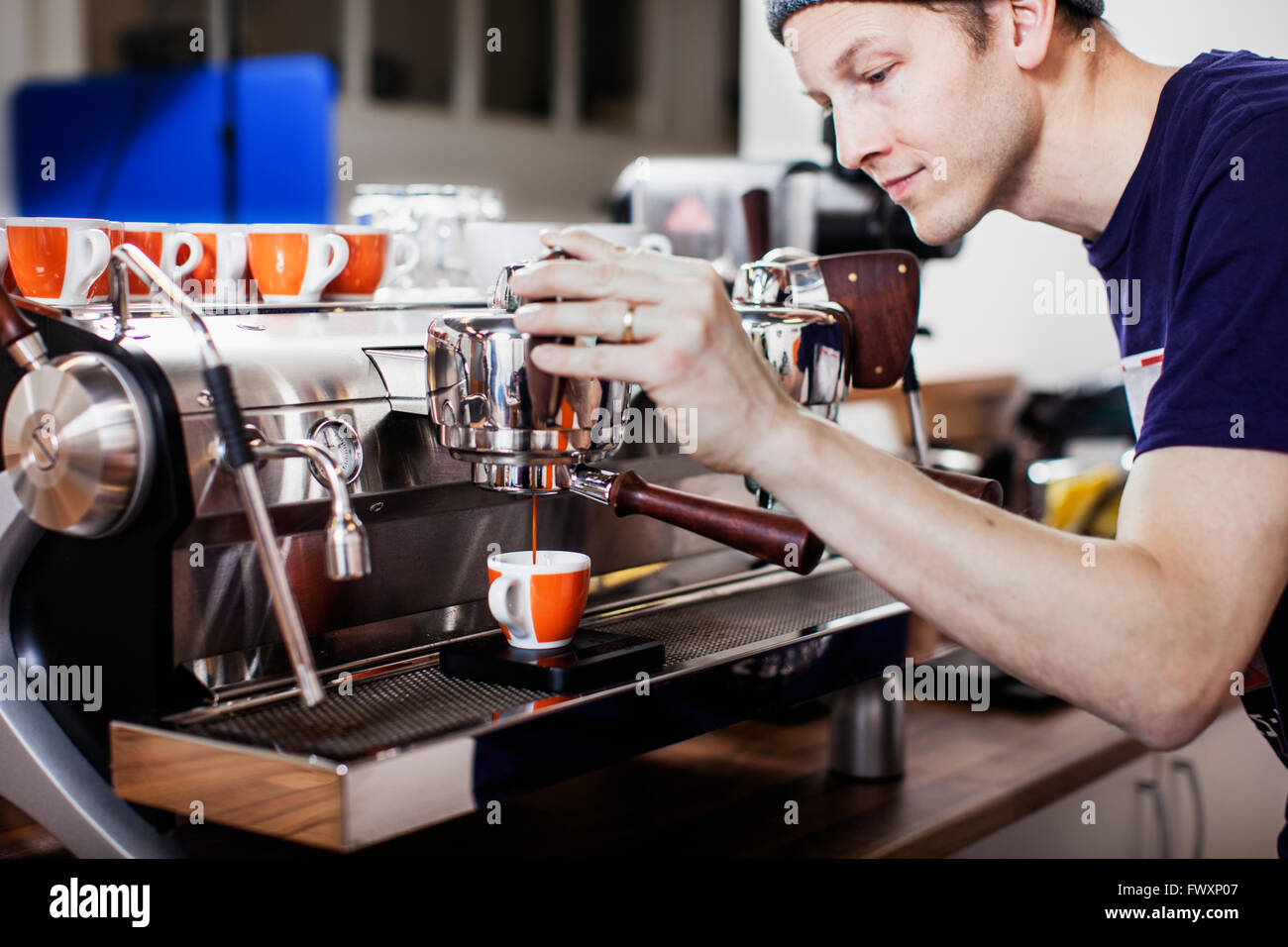 Sweden, Barista making coffee - Stock Image