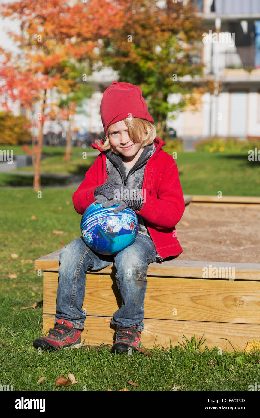 Portrait of boy (6-7) in playground - Stock Image