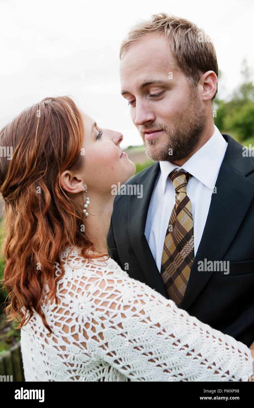 Sweden, Smaland, Bride and groom standing face to face Stock Photo
