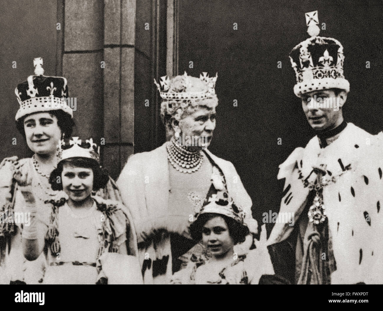 King George VI and his wife Queen Elizabeth seen here on the balcony at Buckingham Palace, London, England the day - Stock Image