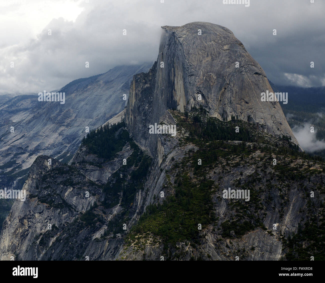 Half Dome, a granite dome in Yosemite valley, Yosemite National Park, California, USA, with vertical one face, round Stock Photo