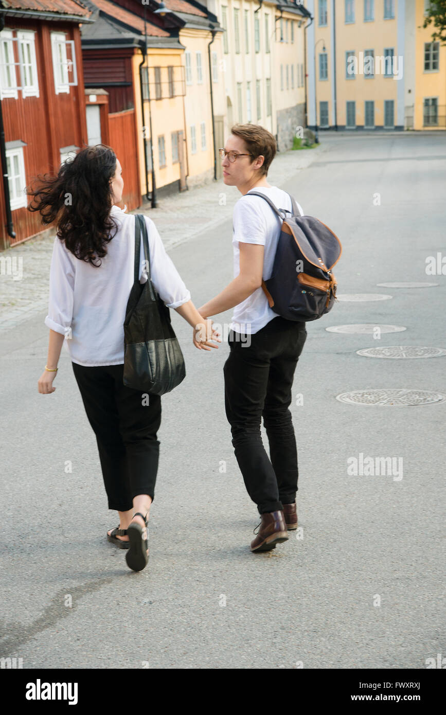 Sweden, Stockholm, Sodermalm, Nytorget, Young couple walking down street - Stock Image