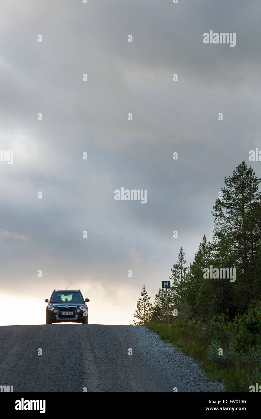 Sweden, Harjedalen, Storsjo, Car on road under overcast sky Stock Photo