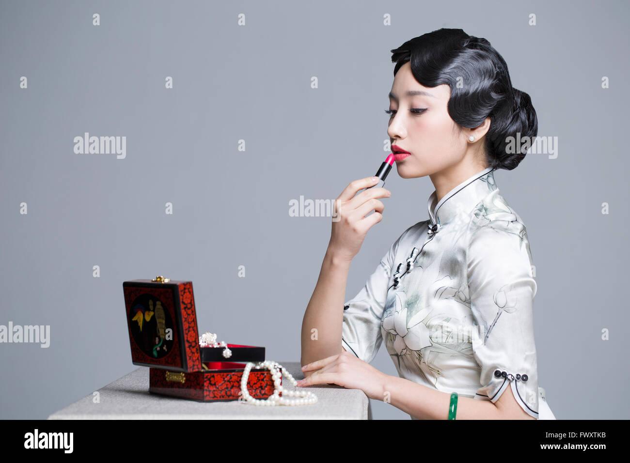 Young Asian Women Applying Lipstick Stock Photos & Young