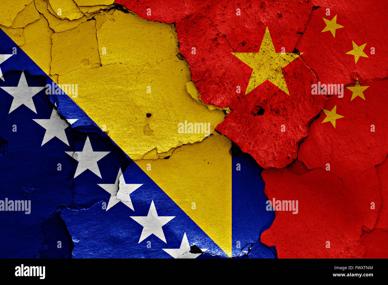 flags of Bosnia and Herzegovina and China painted on cracked wall - Stock Image