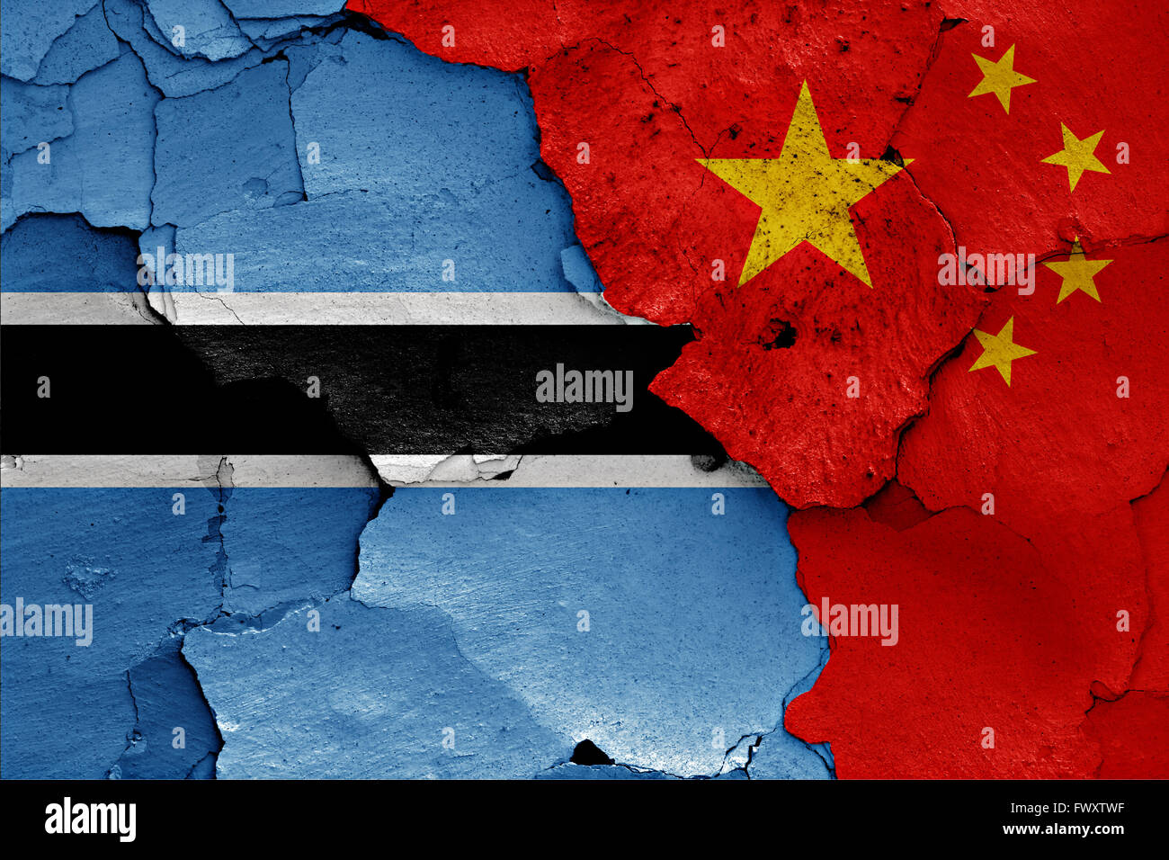 flags of Botswana and China painted on cracked wall - Stock Image