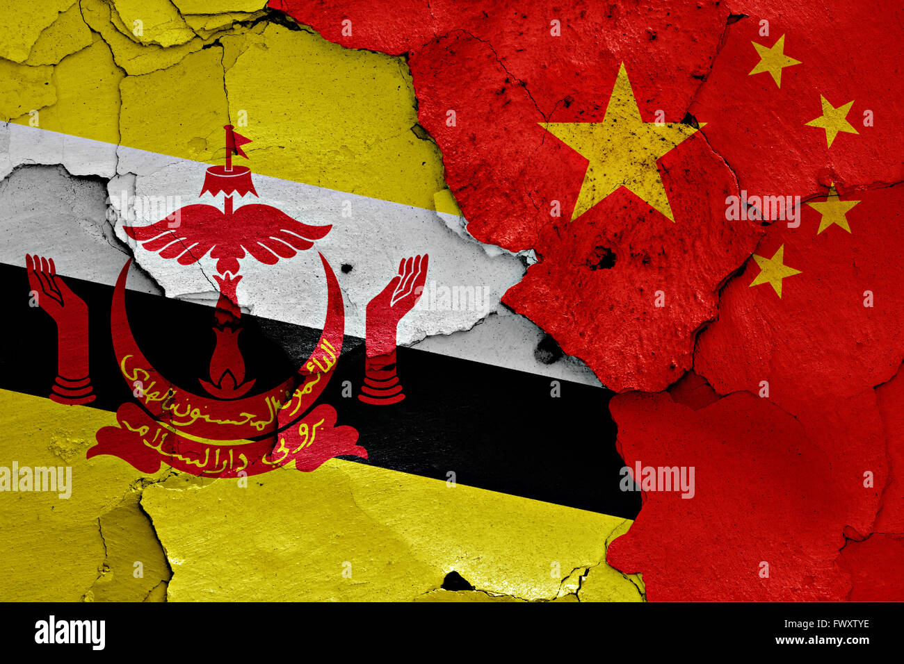 flags of Brunei and China painted on cracked wall - Stock Image