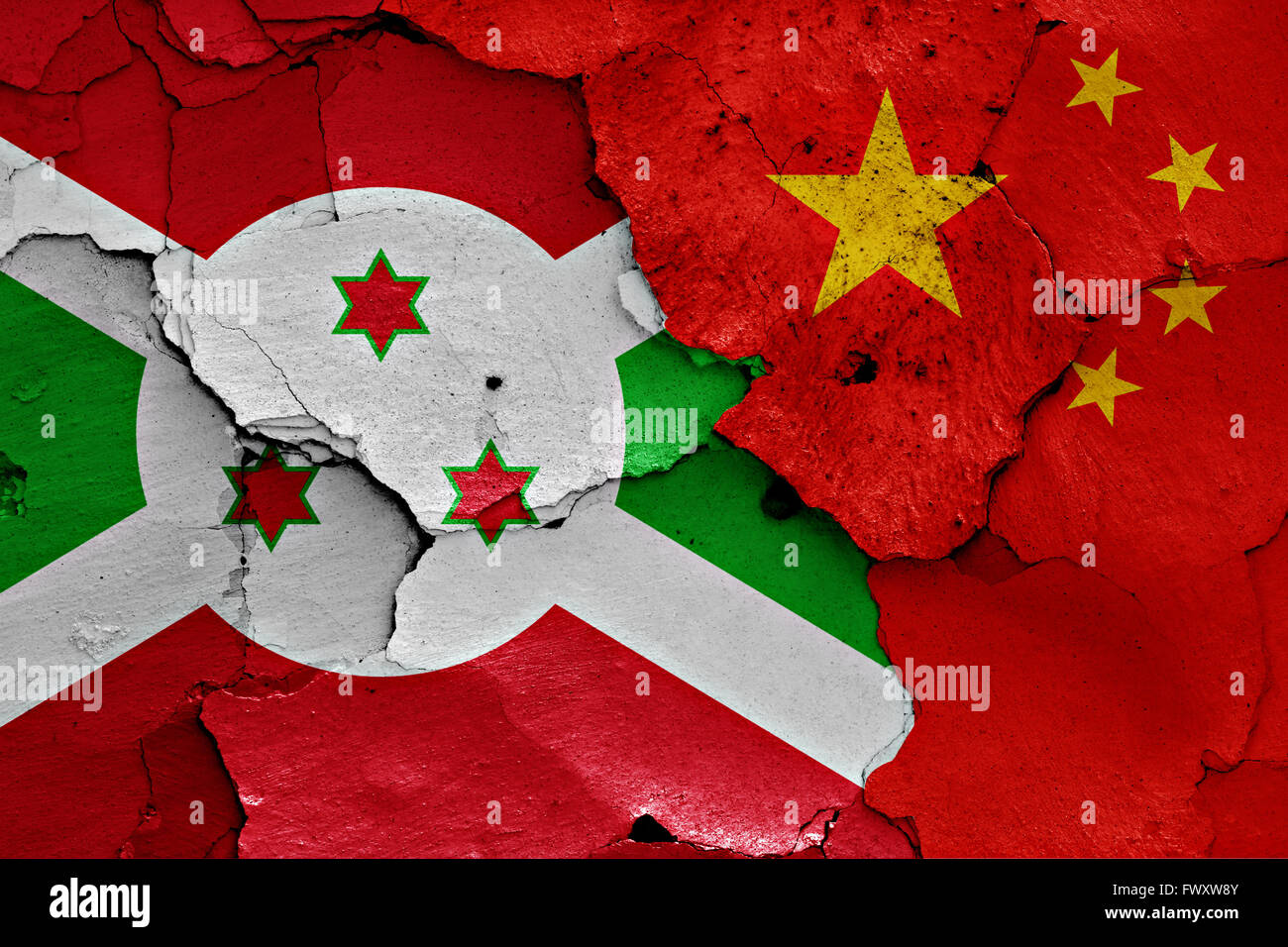 flags of Burundi and China painted on cracked wall - Stock Image