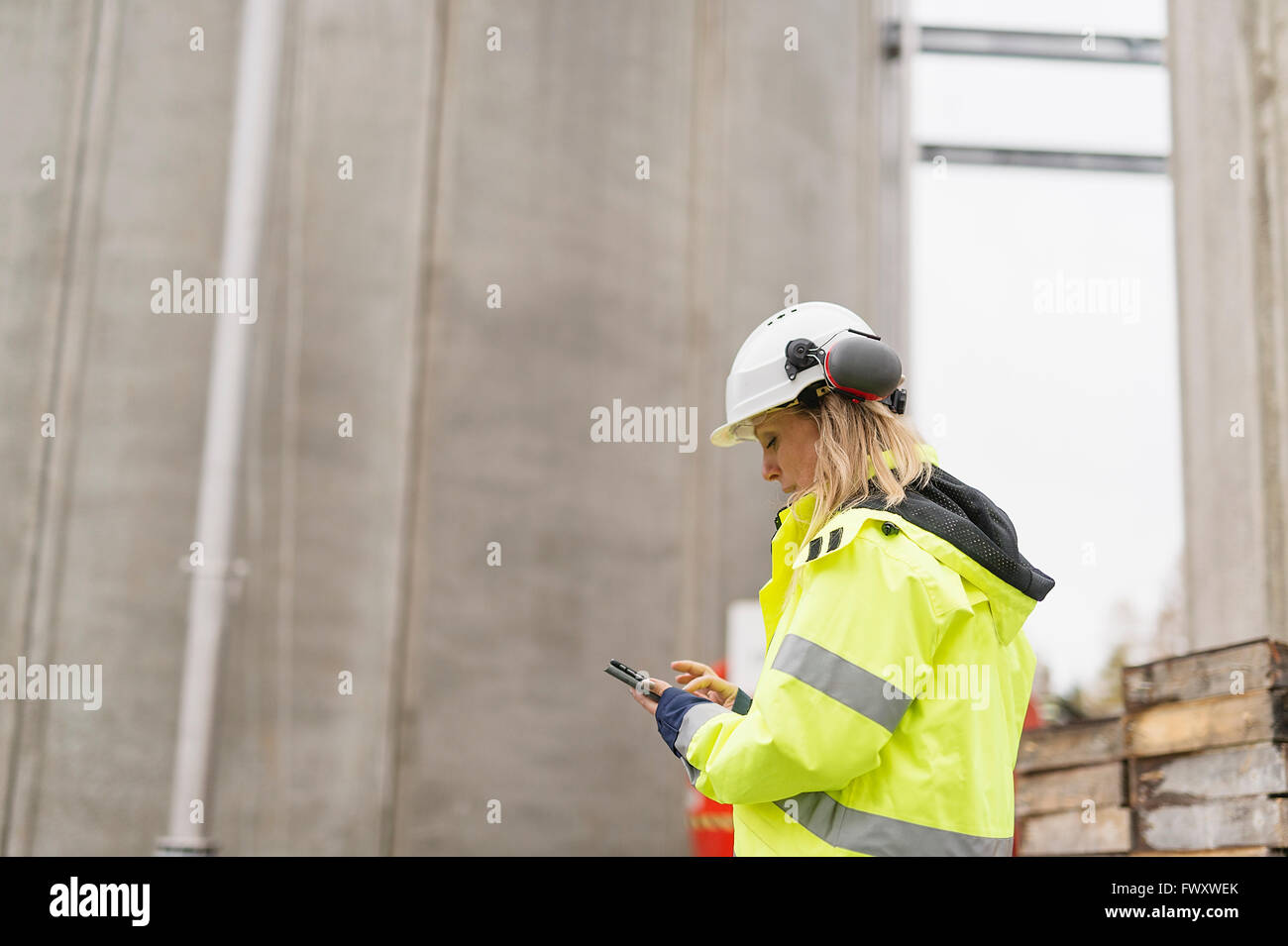 Sweden, Vastmanland, Engineer working at construction site - Stock Image