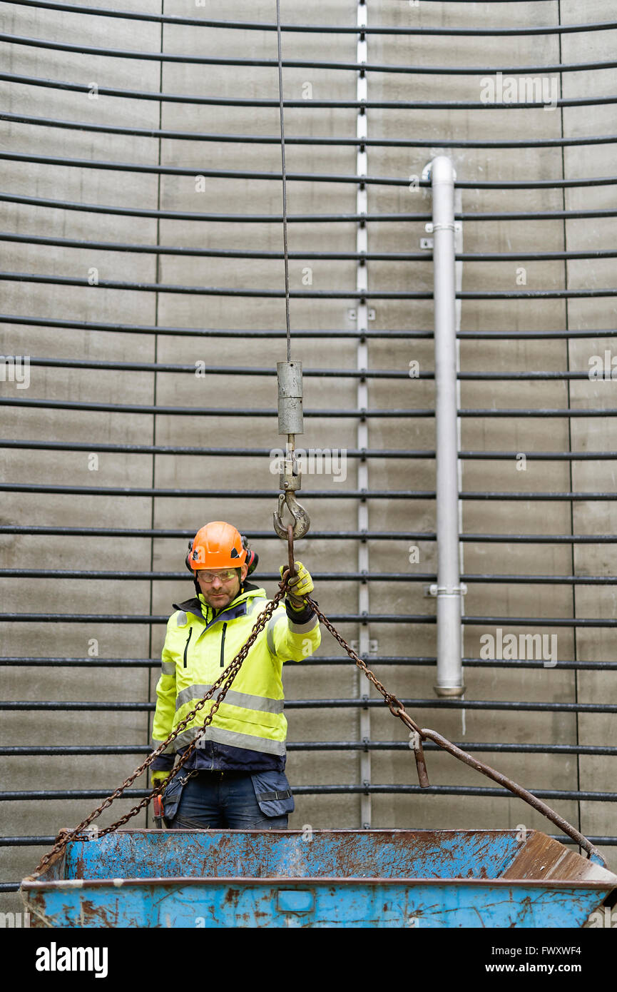 Sweden, Vastmanland, Construction worker standing inside water tower - Stock Image