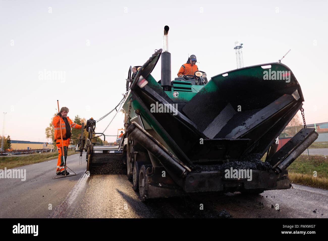Sweden, Narke, Three manual workers repairing road - Stock Image