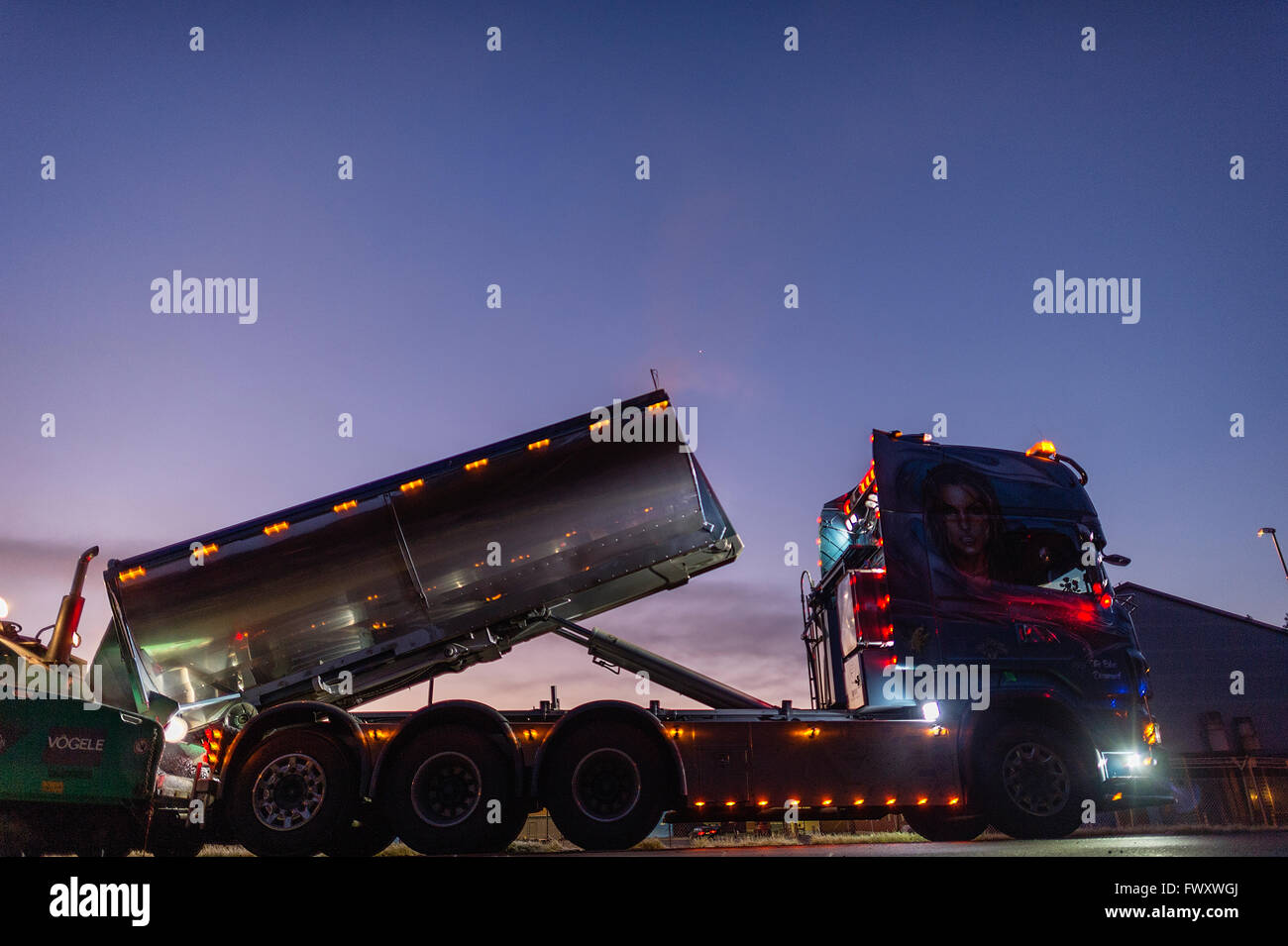 Sweden, Narke, Semi truck on road at night - Stock Image