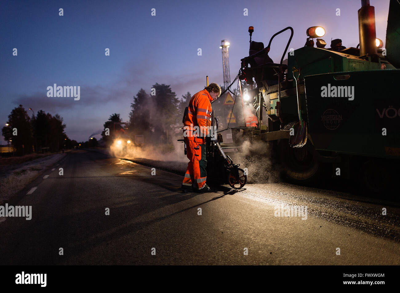 Sweden, Narke, Three manual workers repairing road - Stock Image
