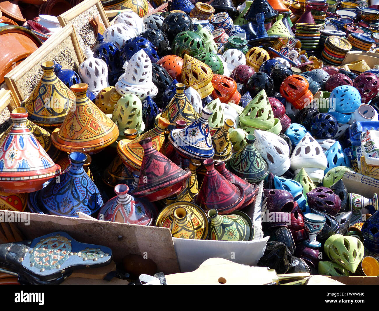Tagine traditional Moroccan earthenware pot are sold in the markets around Morocco - Stock Image