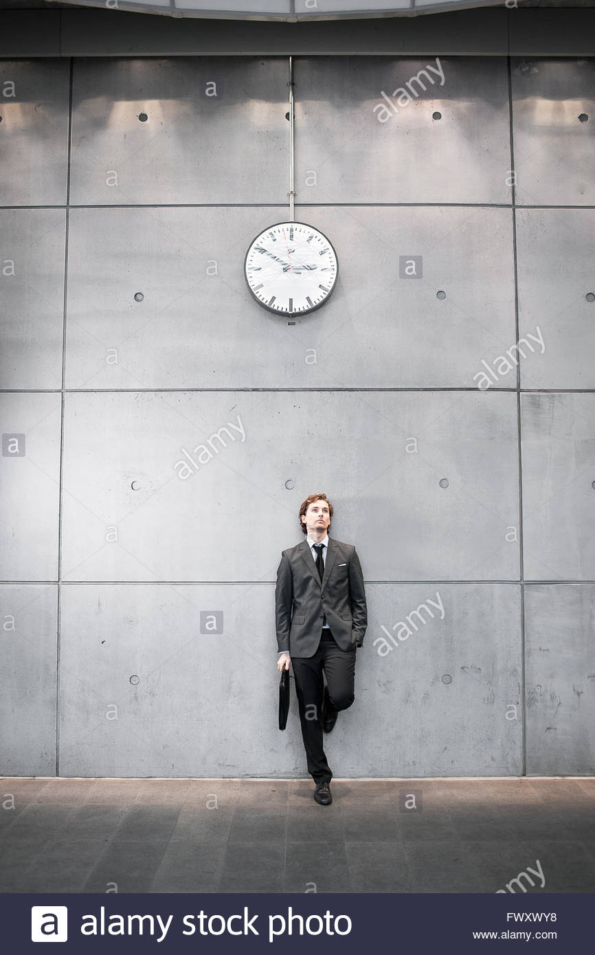 Sweden, Skane, Malmo, Businessman waiting at railroad station - Stock Image