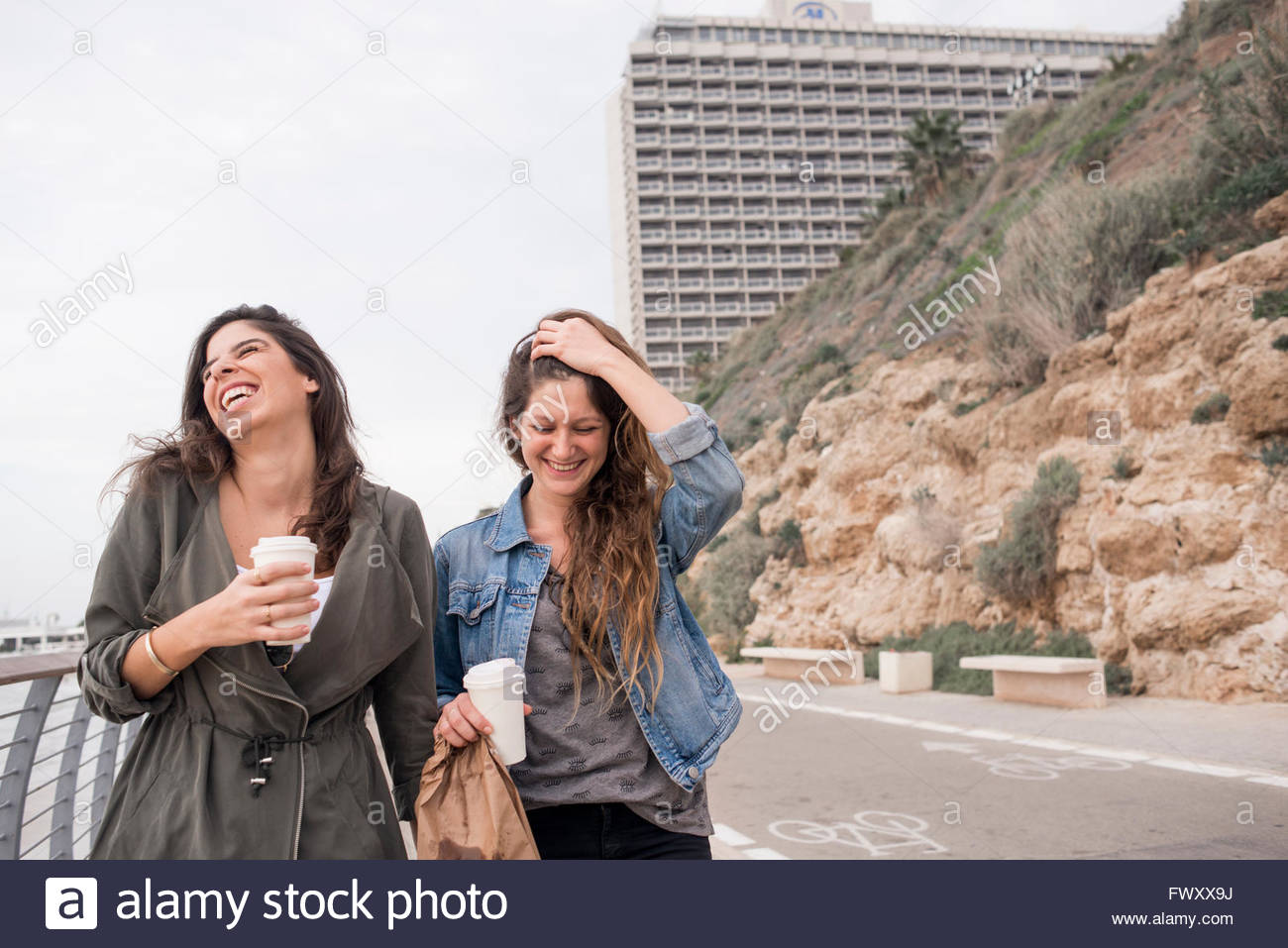 Israel, Tel Aviv, Two smiling women on promenade - Stock Image