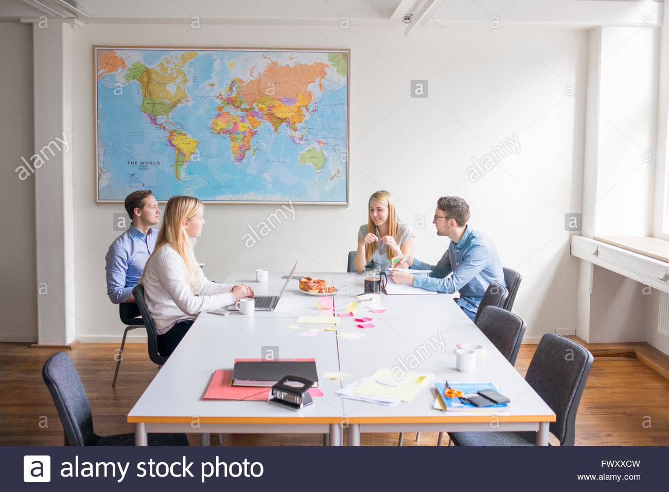 Sweden, Business people talking in board room - Stock Image
