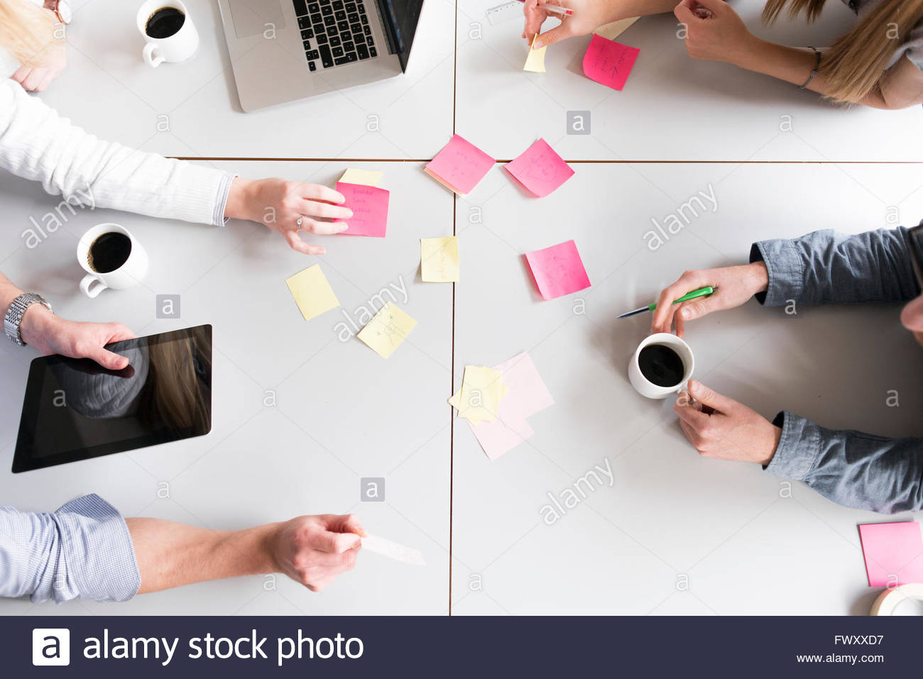 Sweden, Directly above view of adhesive notes on conference table - Stock Image