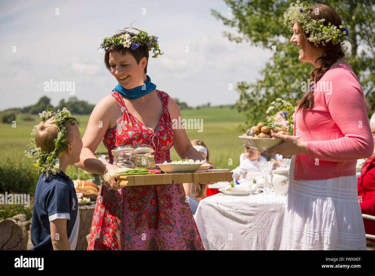 Sweden, Skane, Mother talking with children (6-7, 8-9) during festival - Stock Image