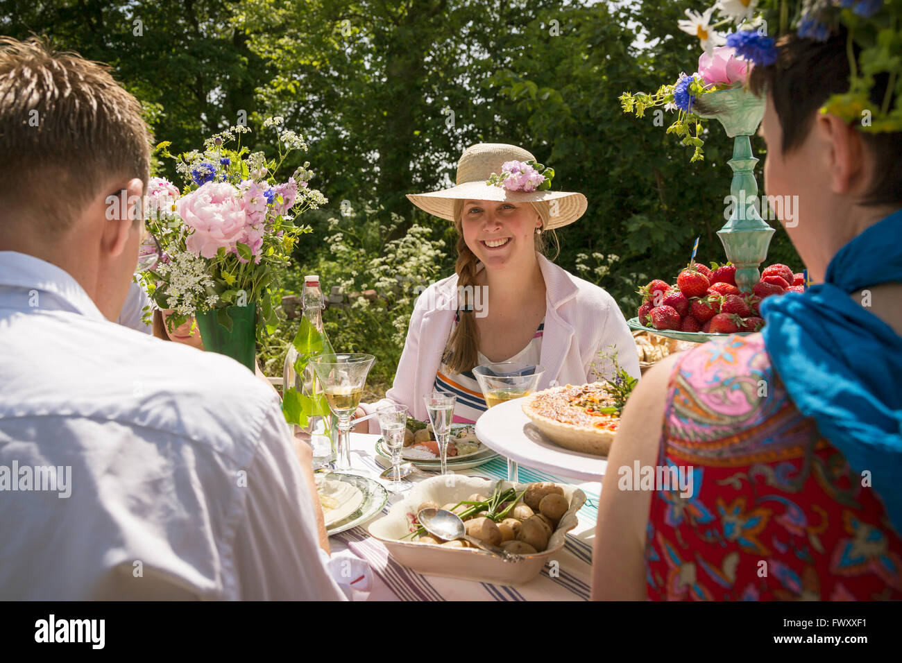Sweden, Skane, Family during midsummer celebrations - Stock Image