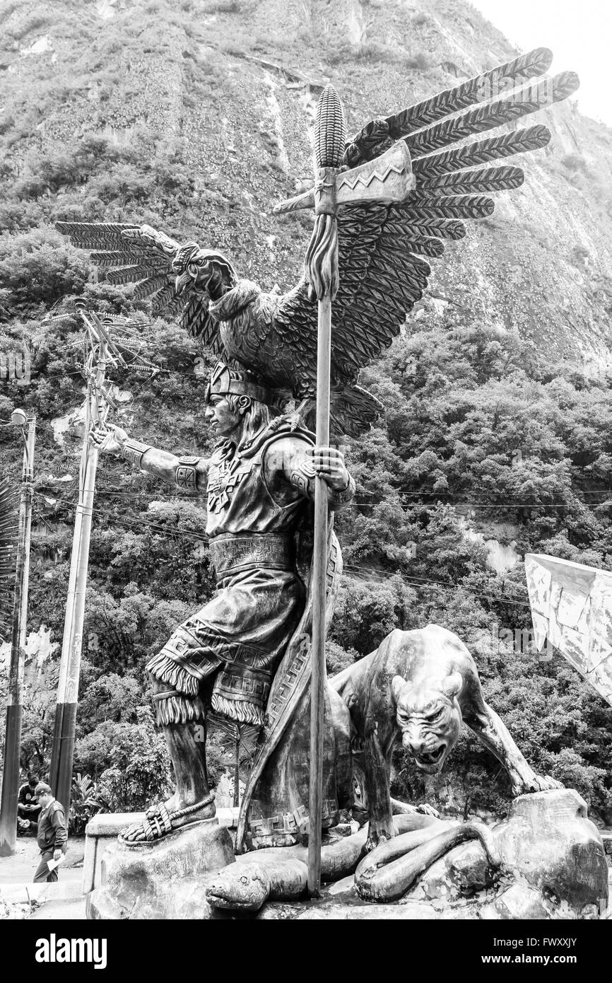 Inca cosmological trilogy statue, anaconda, Puma and condor, with Priest. Machu Picchu village, Peru - Stock Image