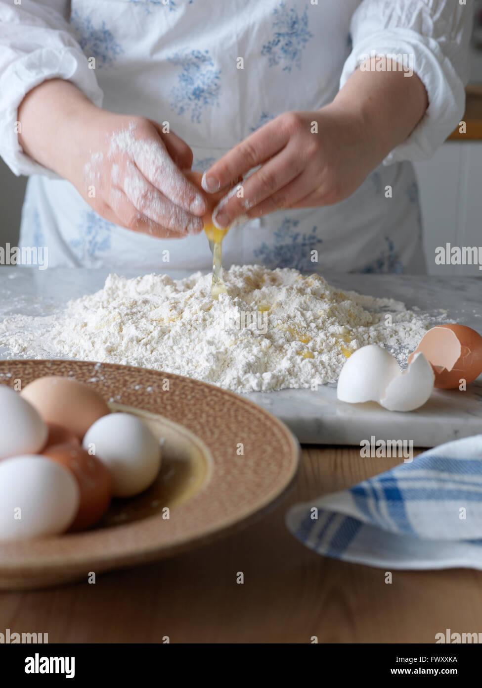 Sweden, Woman making pasta dough - Stock Image