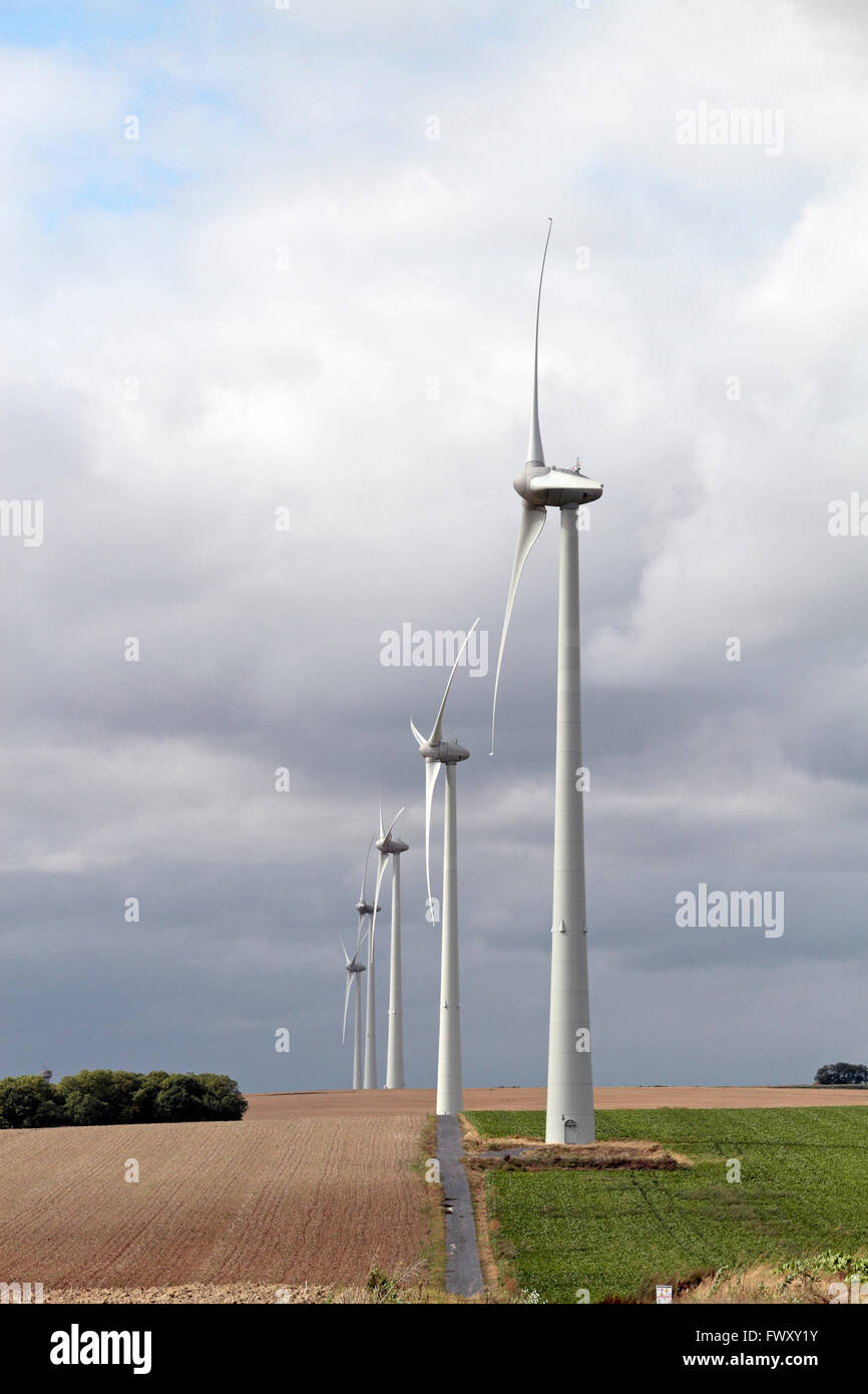 A line of wind turbines in Northern France. - Stock Image