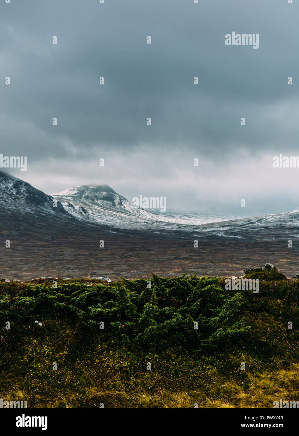 Sweden, Sylama, Jamtland, Landscape with snowcapped mountains and overcast sky - Stock Image