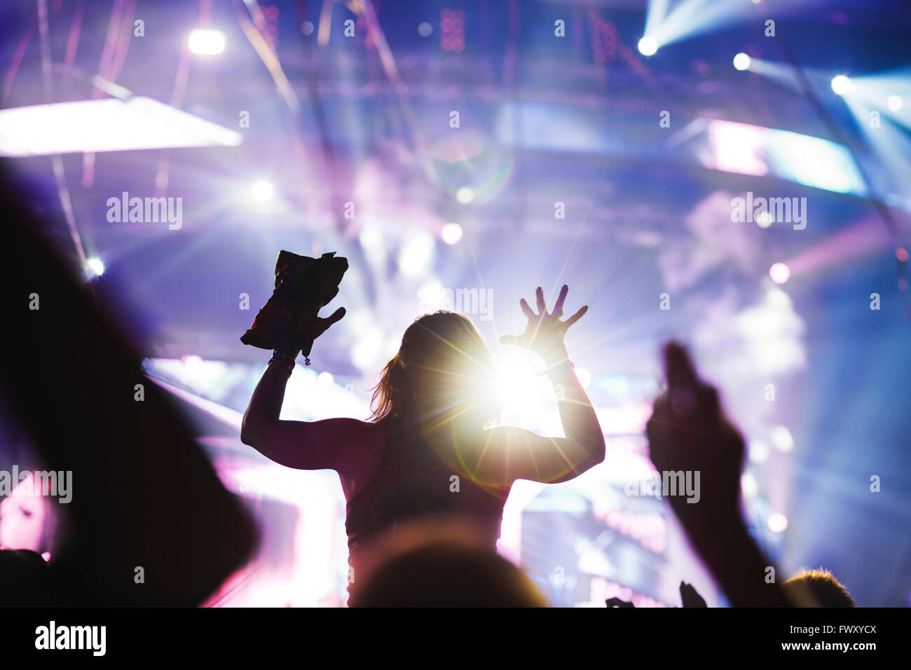 Finland, Uusimaa, Helsinki, Cheering young woman at Summer Sound Festival Stock Photo