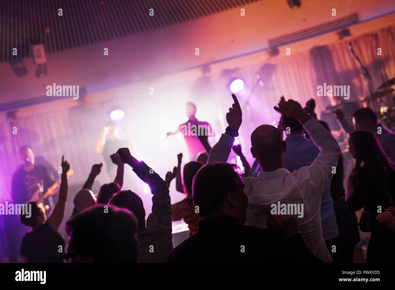 Finland, Varsinais-Suomi, Turku, Fans dancing at music festival - Stock Image