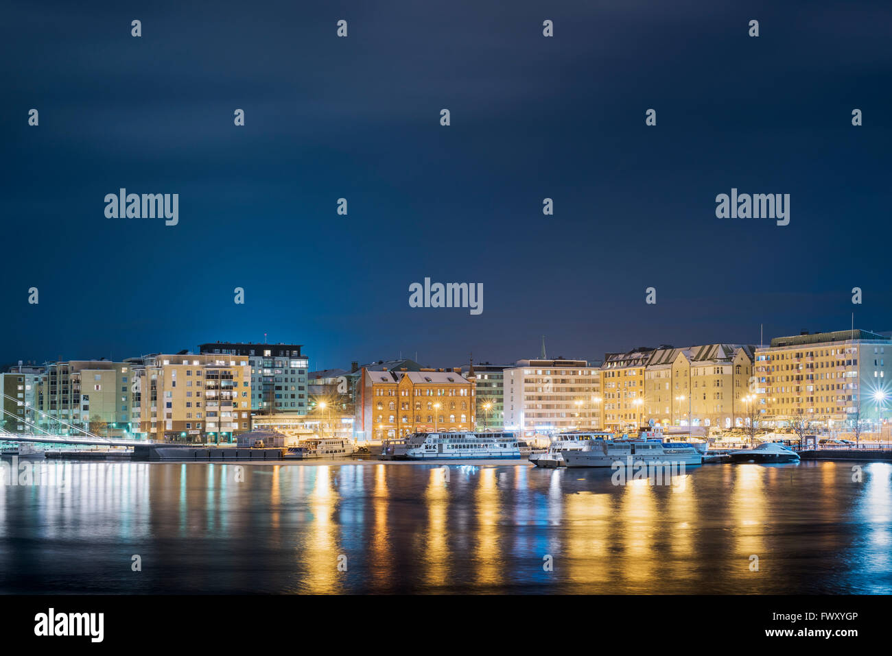 Finland, Pirkanmaa, Tampere, Illuminated waterfront with ships at night Stock Photo