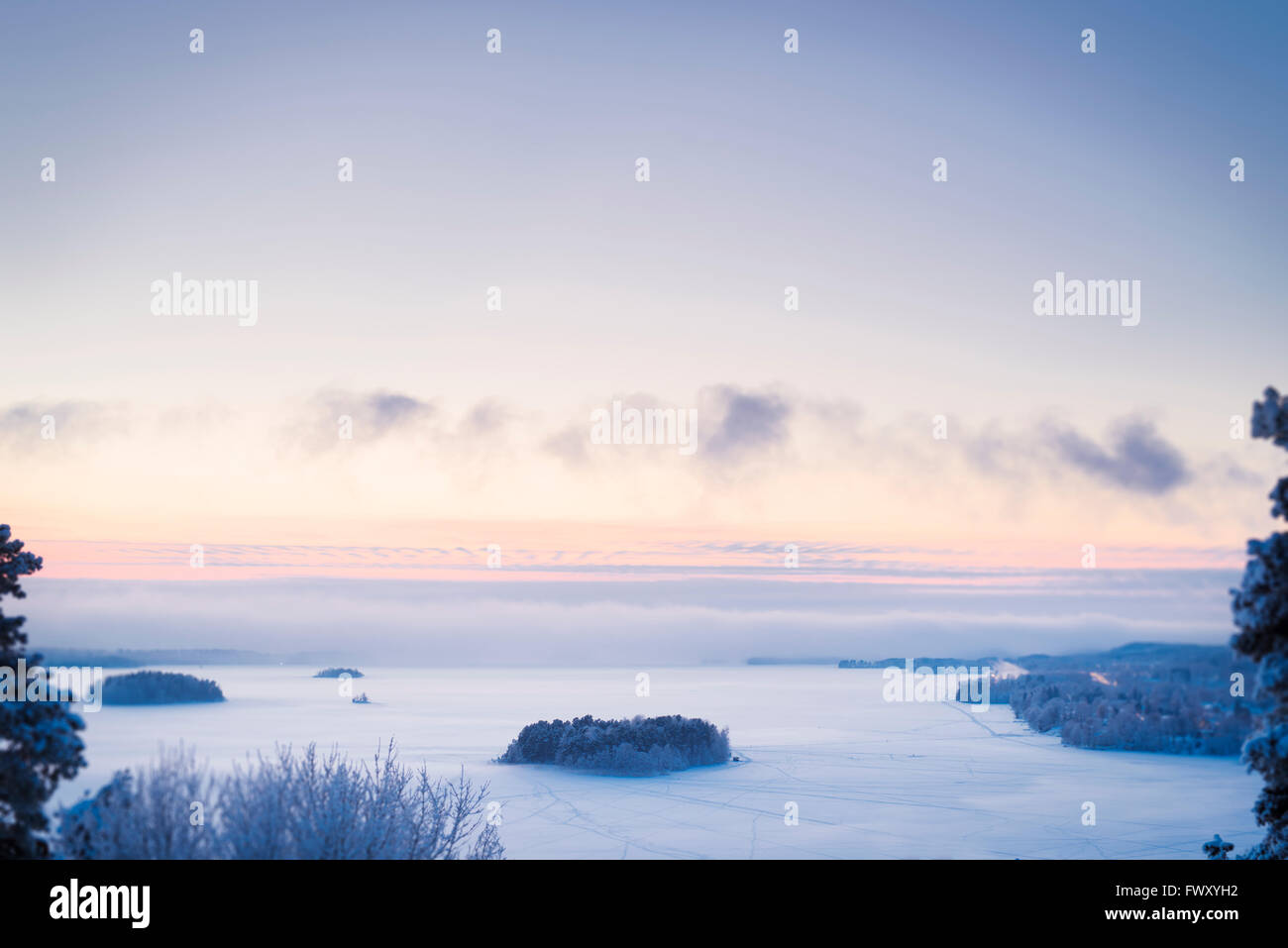 Finland, Pirkanmaa, Tampere, Landscape with frozen lake at dusk Stock Photo