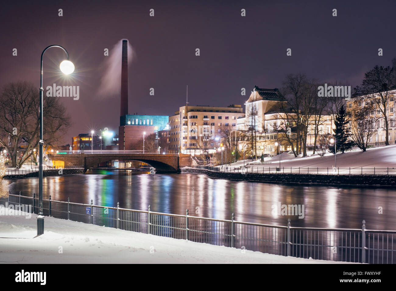 Finland, Pirkanmaa, Tampere, Winter urban scene with riverbank - Stock Image