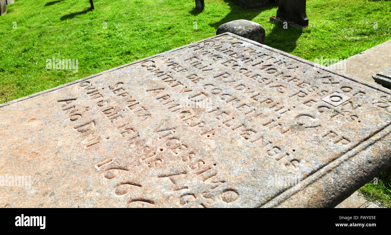 The tomb stone of William Mompesson the rector of St Lawrence's parish Church Eyam Derbyshire England UK - Stock Image