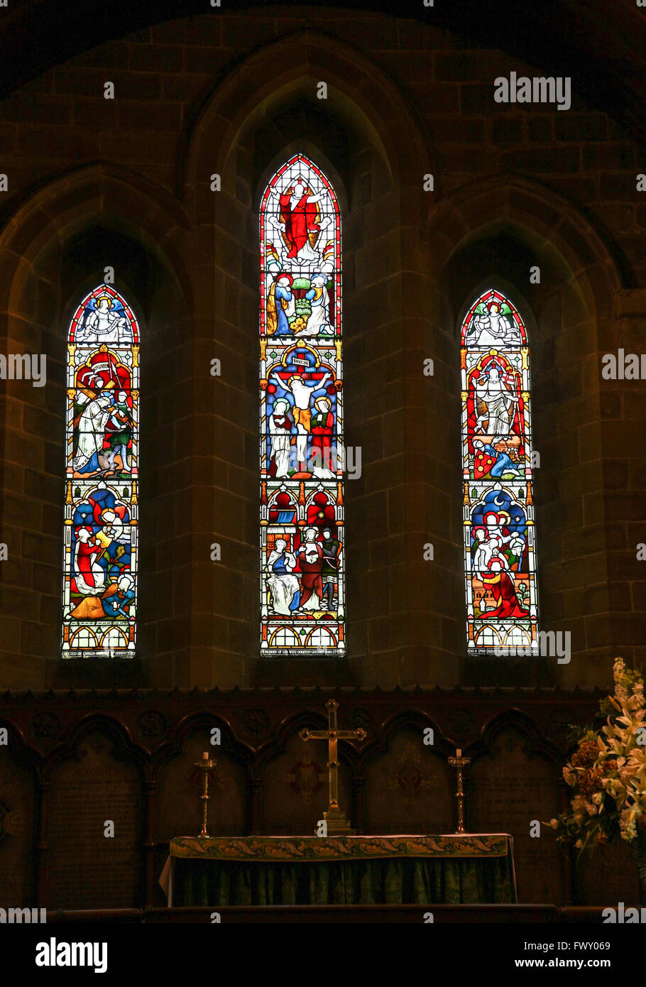 Stained glass window in St Lawrence's parish Church Eyam Derbyshire England UK Stock Photo
