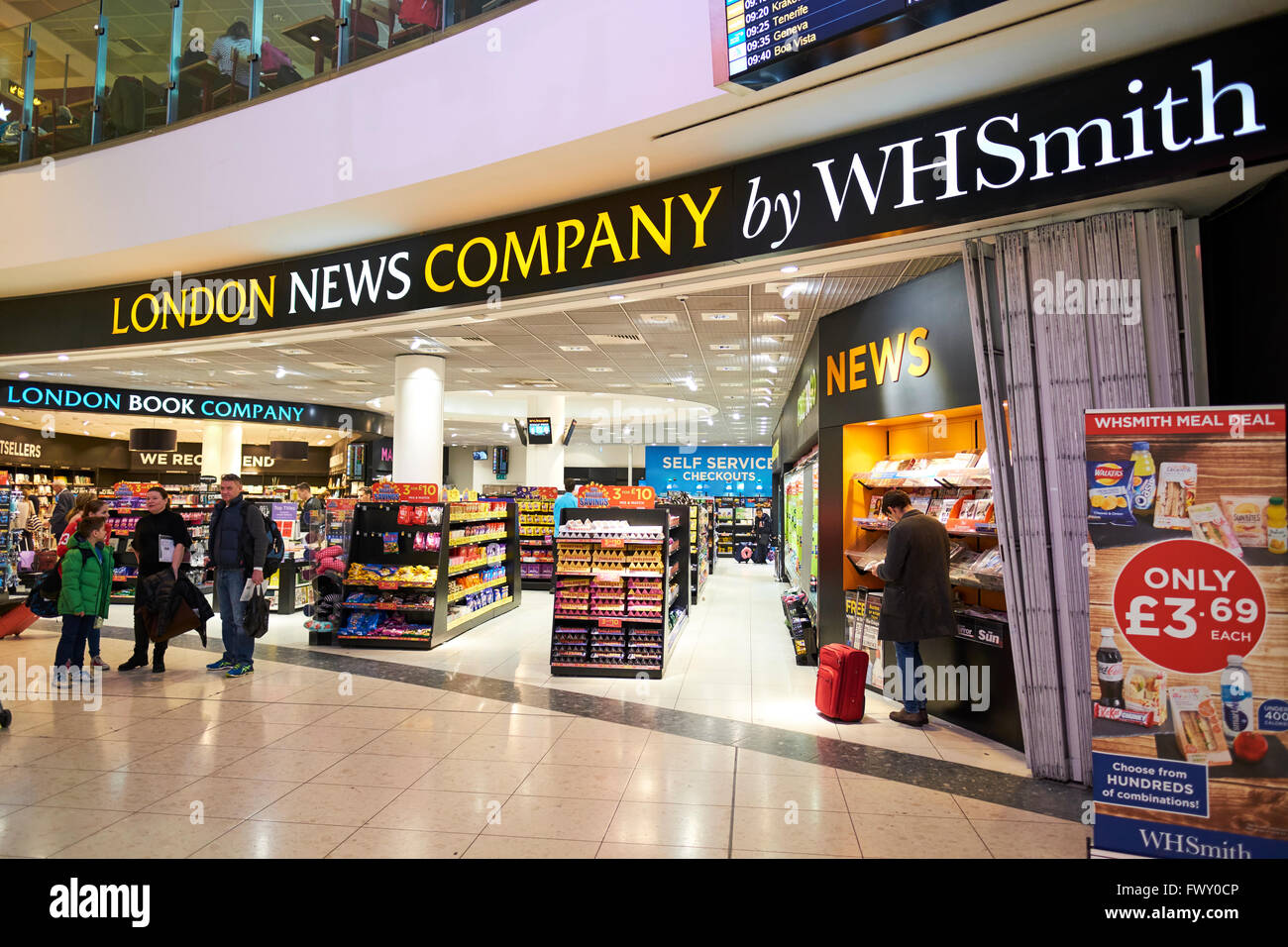 London News Company By WH Smith Duty Free Shop North Terminal Gatwick Airport West Sussex London UK - Stock Image