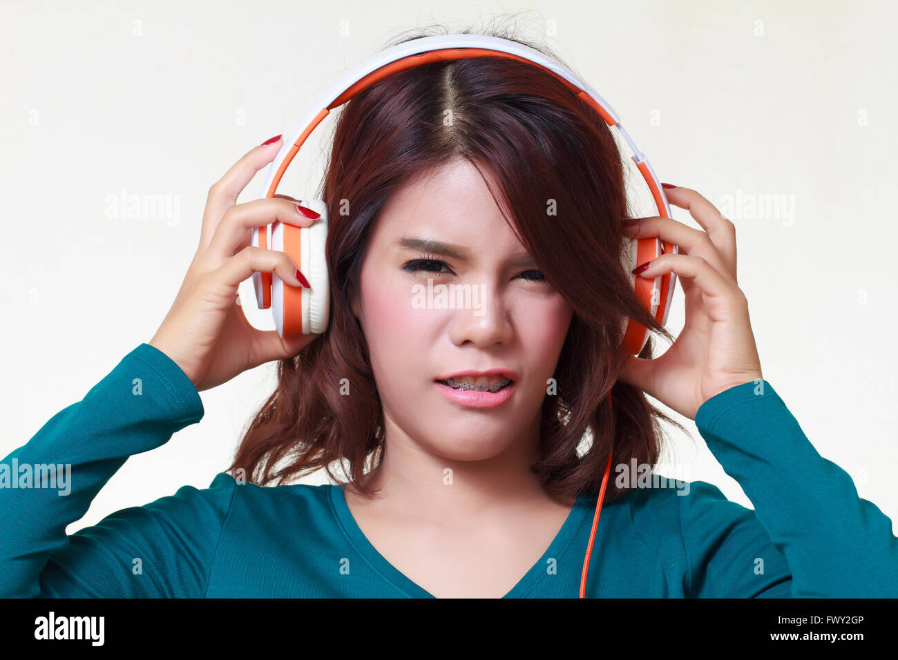 Portrait Of Beautiful Young Woman With Earphones Listening A Bad Stock Photo Alamy