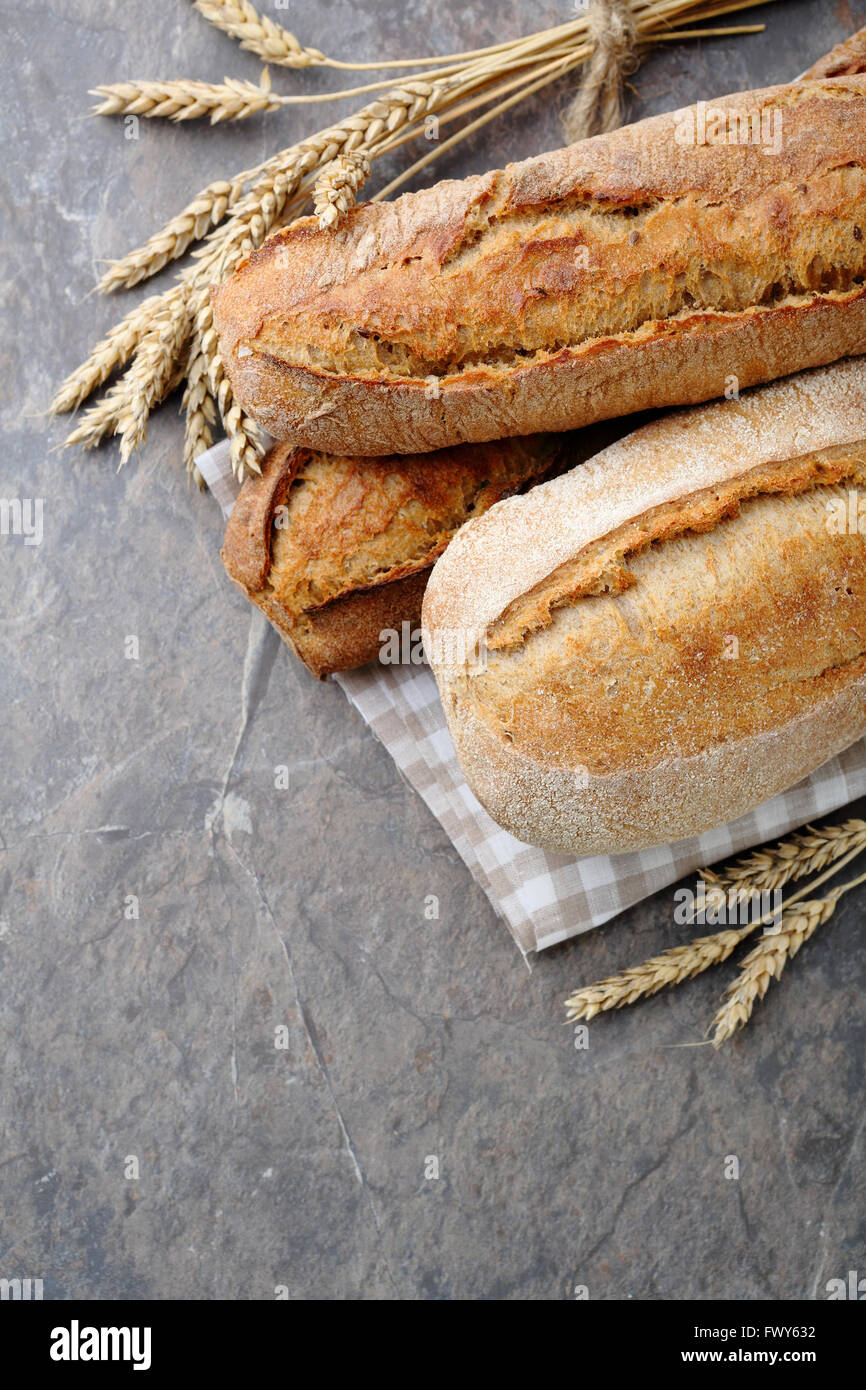loaves of bread on slate, food close-up - Stock Image