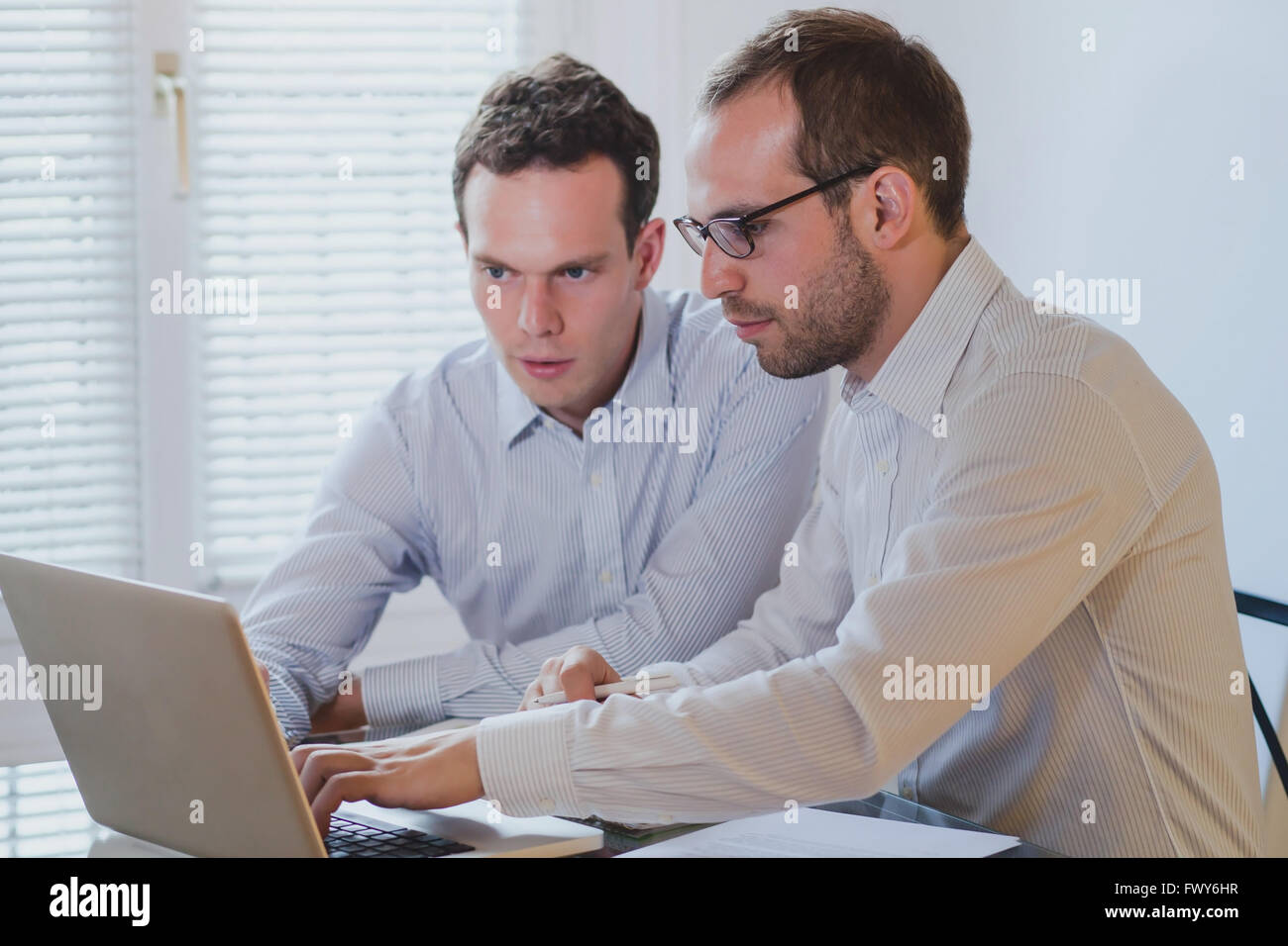 financial analysis and project management, business  people working with computer in modern office interior - Stock Image
