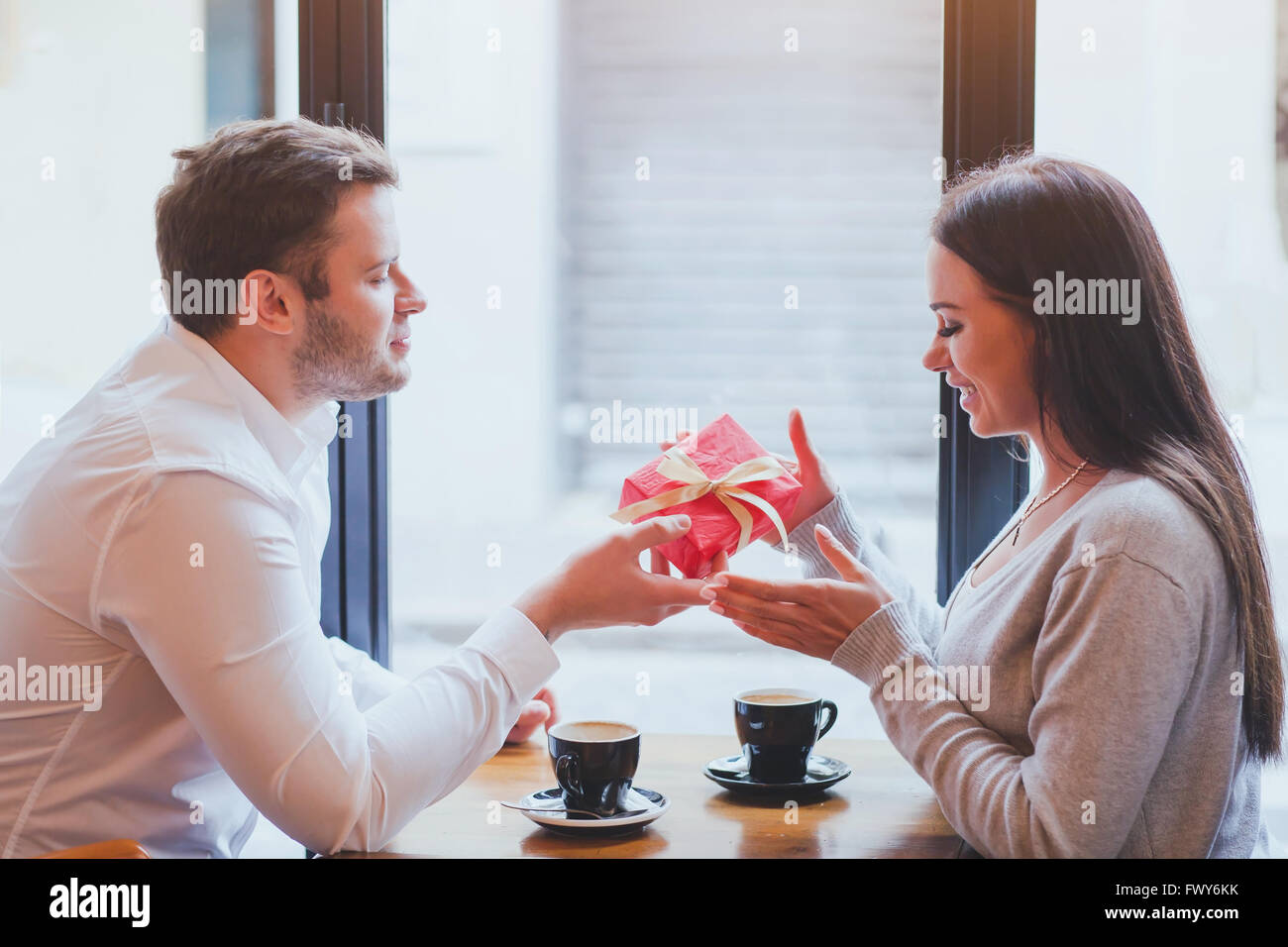 man and woman, gift, romantic dating - Stock Image