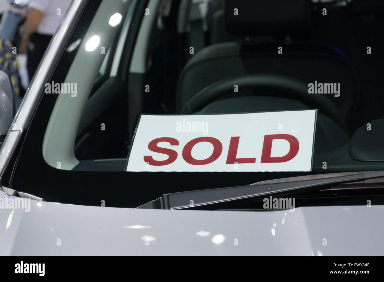 Sold label in the new car at car showroom Stock Photo