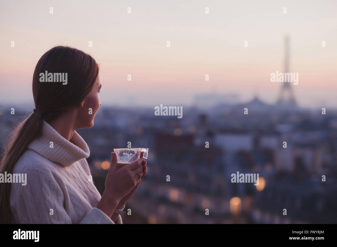 travel to Paris, woman looking at Eiffel tower and beautiful panorama of the city - Stock Image