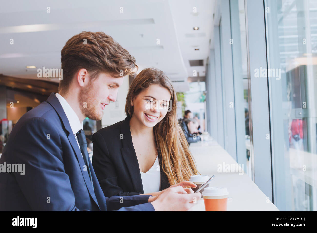 business people chatting in cafe at lunch or coffee break - Stock Image