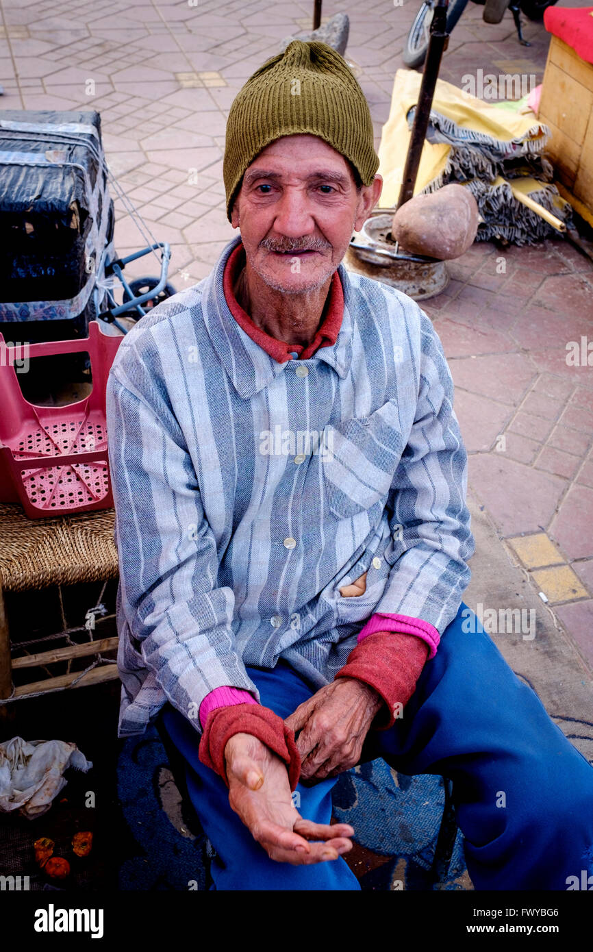 Portrait of a man who earns his living by shining shoes in the Jemaa el Fna, Marrakech, Morocco, North Africa Stock Photo