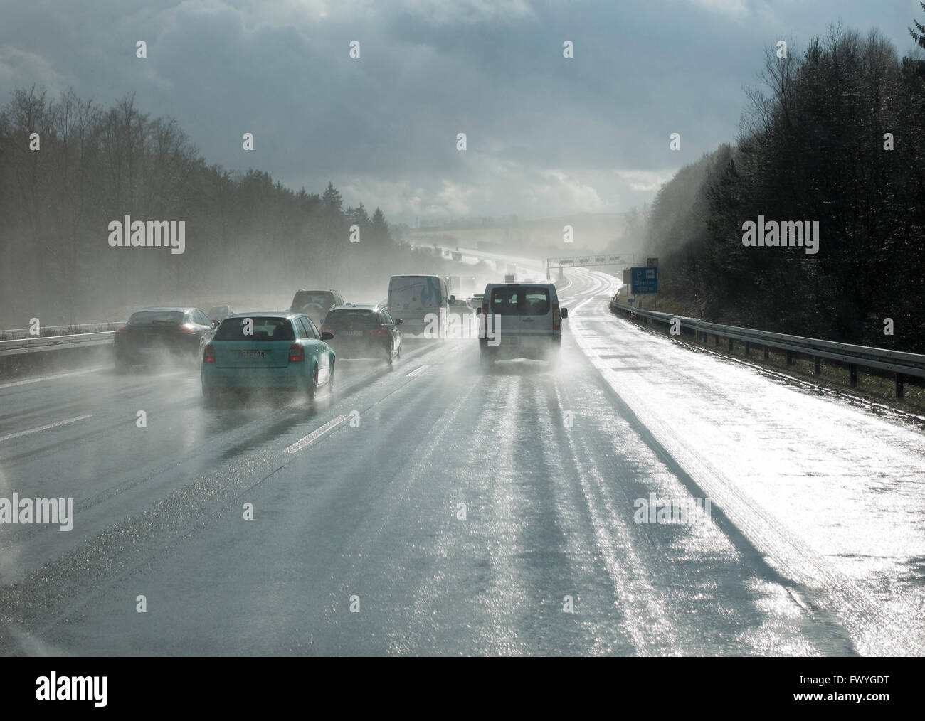 Cars overtaking in the rain, poor visibility, motorway A9, Thuringia, Germany - Stock Image