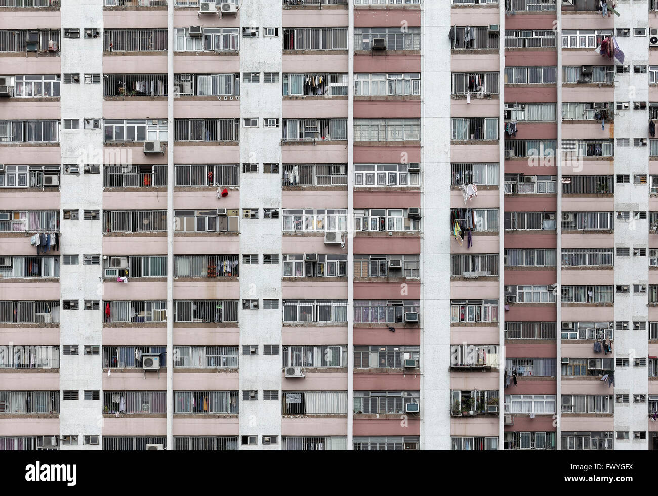 Sky scraper front with external air conditioners, Ping Shek Estate, housing development from 1970, Kwun Tong District, - Stock Image