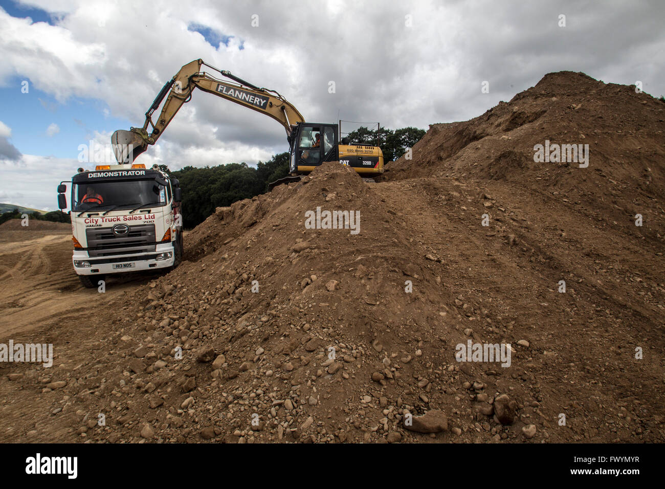 Diggers working in Quarry for Borders railway Construction, Scotland - Stock Image